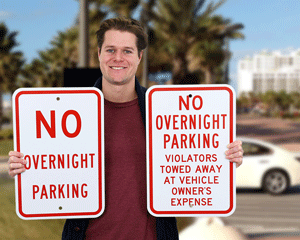 No overnight parking towed away signs