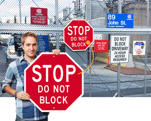 Stop do not block driveway sign