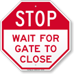 Stop, Wait For Gate To Close Sign
