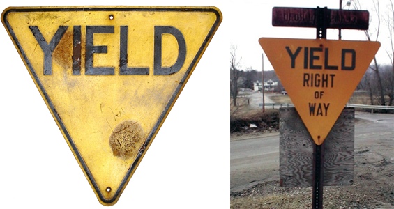 Old-style yellow yield signs