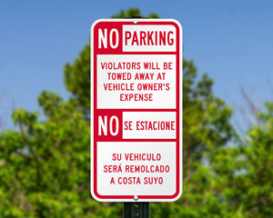 Bilingual tow away parking sign