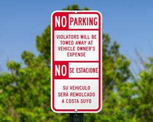 Bilingual tow away parking sign