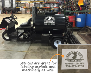 Custom stencils on asphalt and machinery