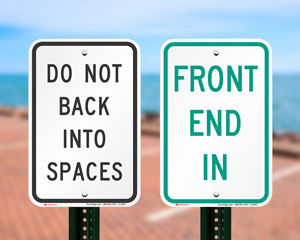 Do not back into parking space signs
