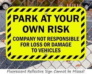 Fluorescent park at your own risk sign
