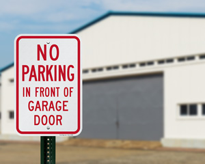 No Parking in Front of Garage Door Sign