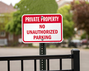 Private property no unauthorized parking sign