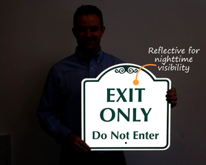 Reflective exit only sign