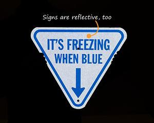 Reflective ice alert sign