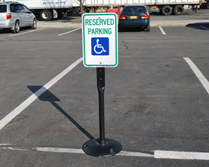 Reserved handicapped parking sign on a stand