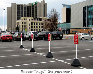 Rubber sign bases for parking lot
