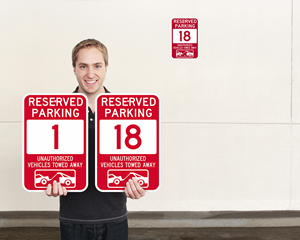 Red Reserved Parking Spot Signs