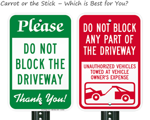 Two different strategies for do not block driveway signs