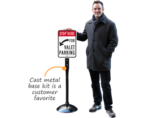 Valet parking sign on a cast iron sign base
