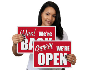 We are open and back in business signs