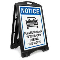 NOTICE: Please Remain in Your Car During the Movie Sidewalk Sign