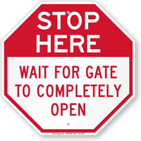 Stop Here Wait For Gate To Completely Open Sign