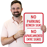 Bilingual No Parking Between Sign
