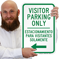 Bilingual Visitor Parking Only With Left Arrow Sign