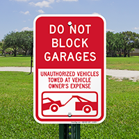 Do Not Block Garages Unauthorized Vehicles Towed Signs
