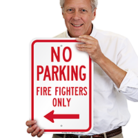 No Parking Firefighters Only Sign With Left Arrow
