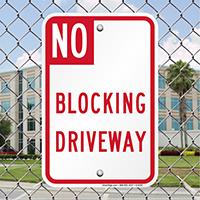 NO BLOCKING DRIVEWAY Signs