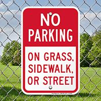 No Parking On Grass, Sidewalk, Or Street Signs