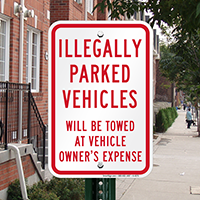 Illegally Parked Vehicles Towed Signs