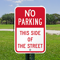 No Parking, This Side Of The Street Signs