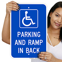 Parking And Ramp In Back With Graphic Signs