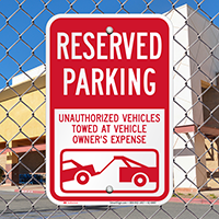Reserved Parking, Vehicles Towed At Owner Expense Signs
