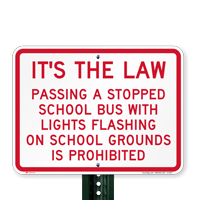 Passing Stopped Bus with lights prohibited Signs