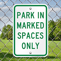 Park in Marked Spaced Only Sign