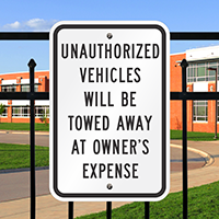 Unauthorized Vehicles Towed Signs