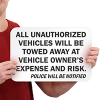 All Unauthorized Vehicles Towed Signs