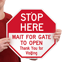 Stop Here Wait For Gate To Open Signs