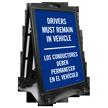 Bilingual Drivers Remain in Vehicle Sidewalk Sign