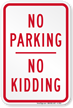 No Parking No Kidding Sign