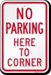 No Parking Here Corner Sign