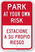 Park At Own Risk Bilingual Sign