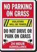No Parking On Grass Violators Towed Surveillance Sign