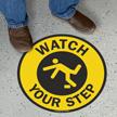 Circular Watch Your Step Anti-Skid Vinyl Floor Sign