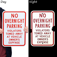 No Parking Violators Towed Away at Vehicle Owner's Expense Sign