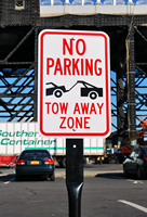 No Parking Tow Zone with Tow Truck Symbol Sign