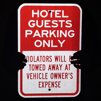 Violators Will Be Towed, Hotel Guests Parking Only Sign