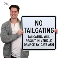 Tailgating Will Result In Vehicle Damage by Gate Sign