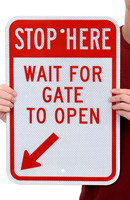STOP Here Wait For Gate To Open sign