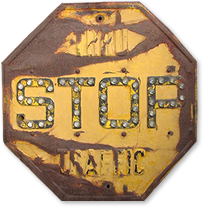 Yellow old-style stop sign from 1940s